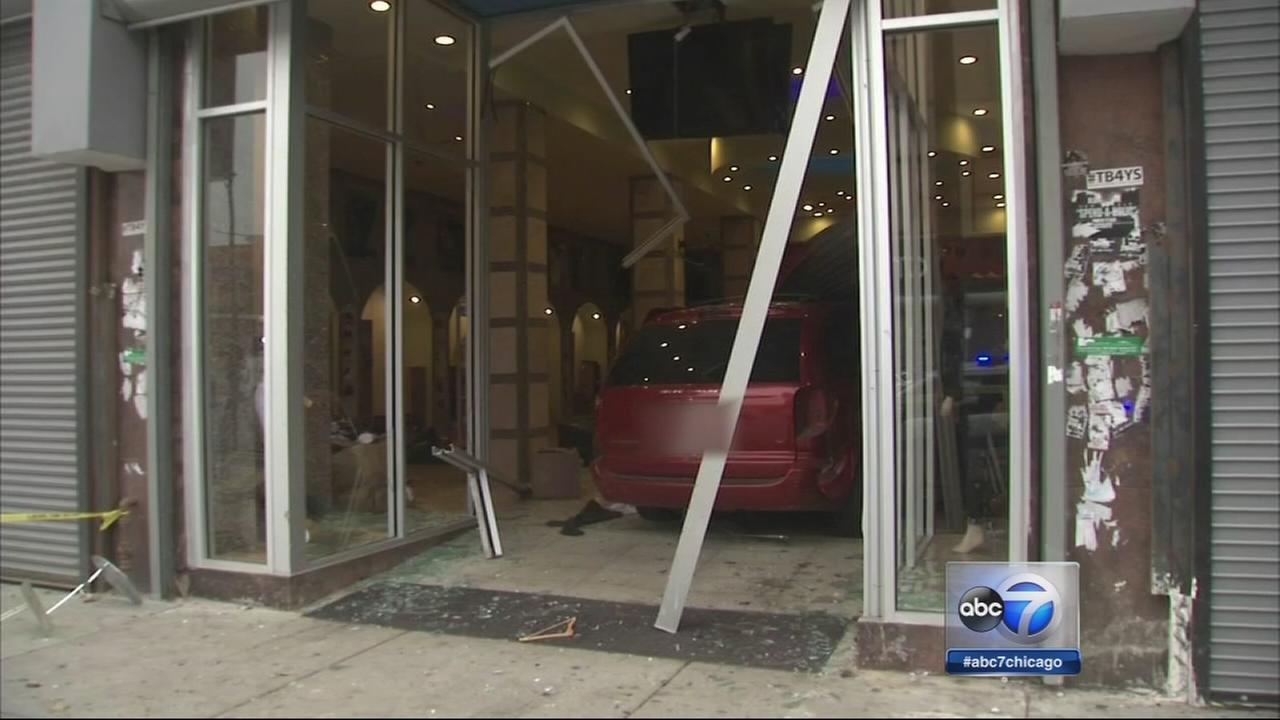 Van carrying at least 15 smashes into store