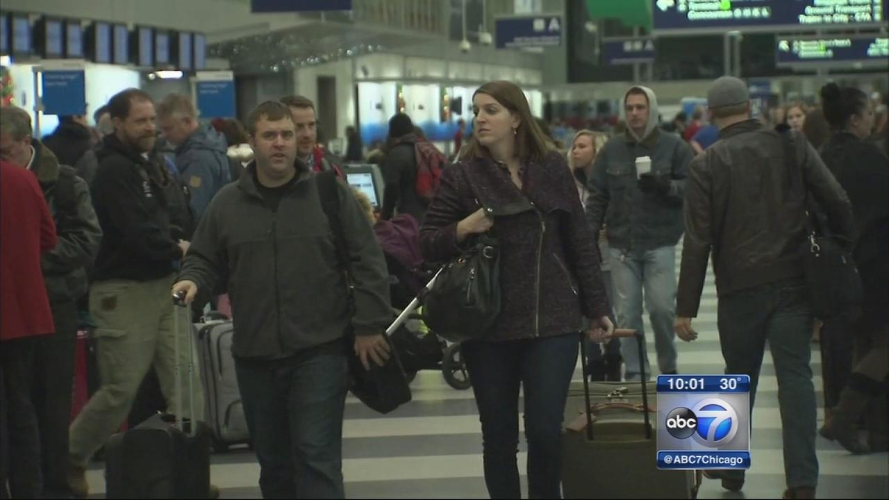 Holiday travelers greeted with long lines, few delays