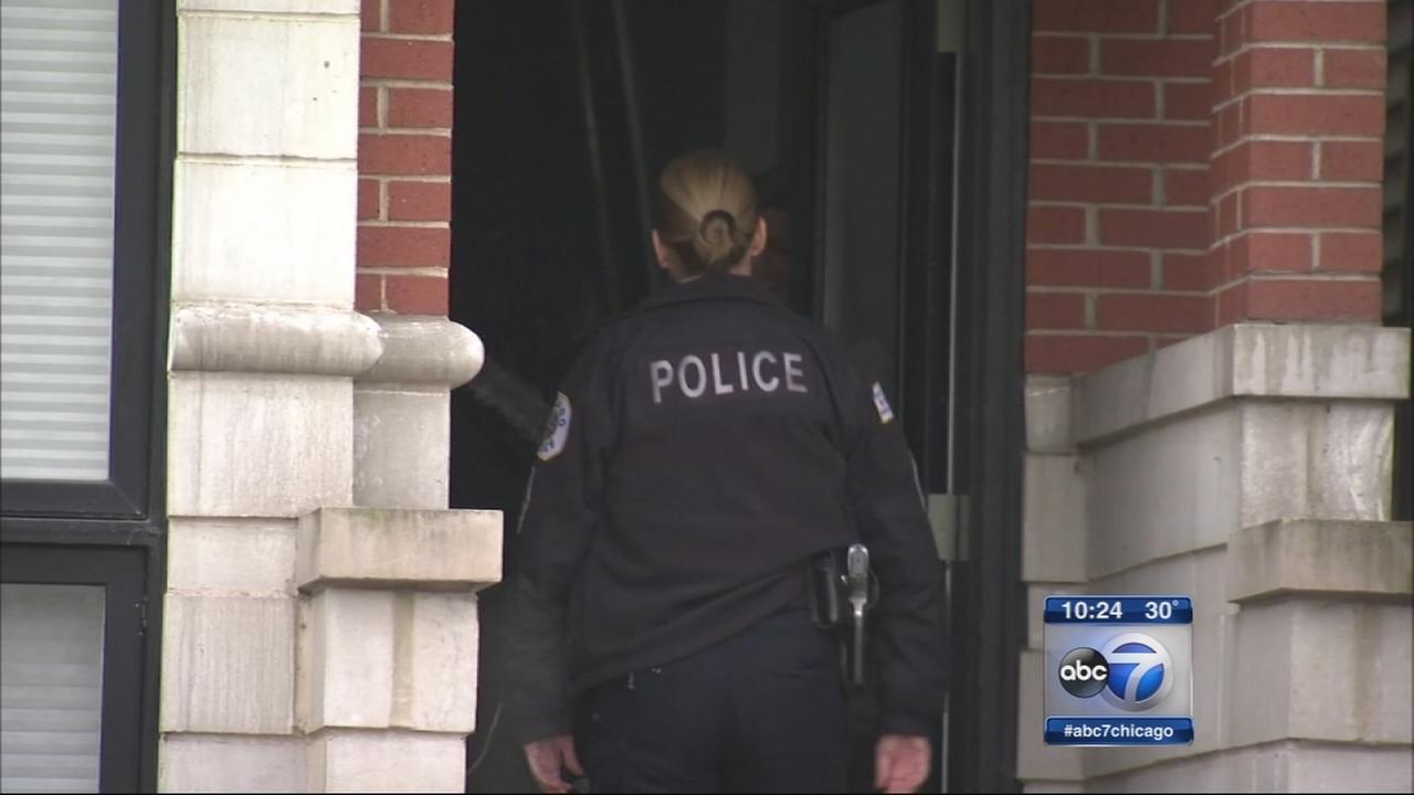 Police remove evidence from Wrigleyville home
