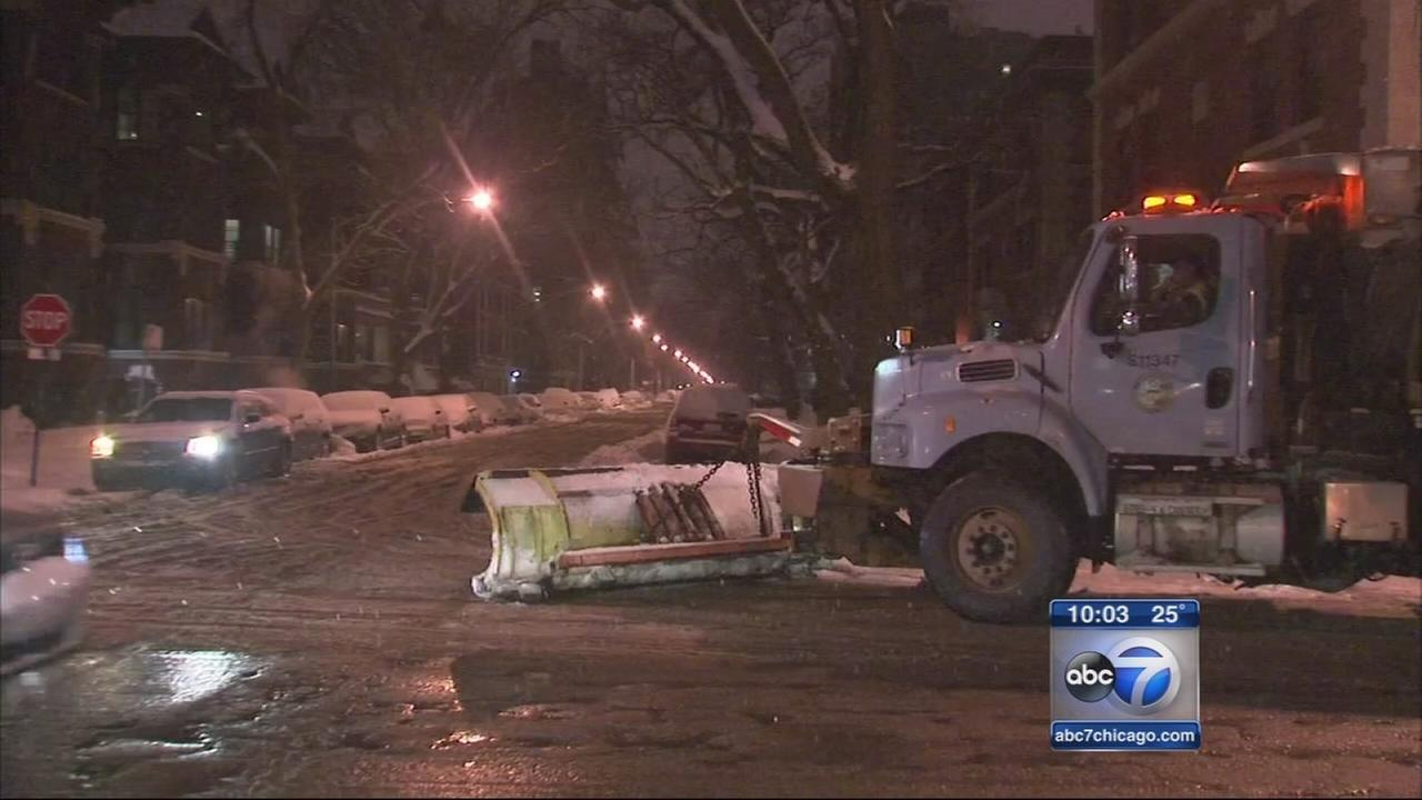 More snow falls as city plows tackle side streets