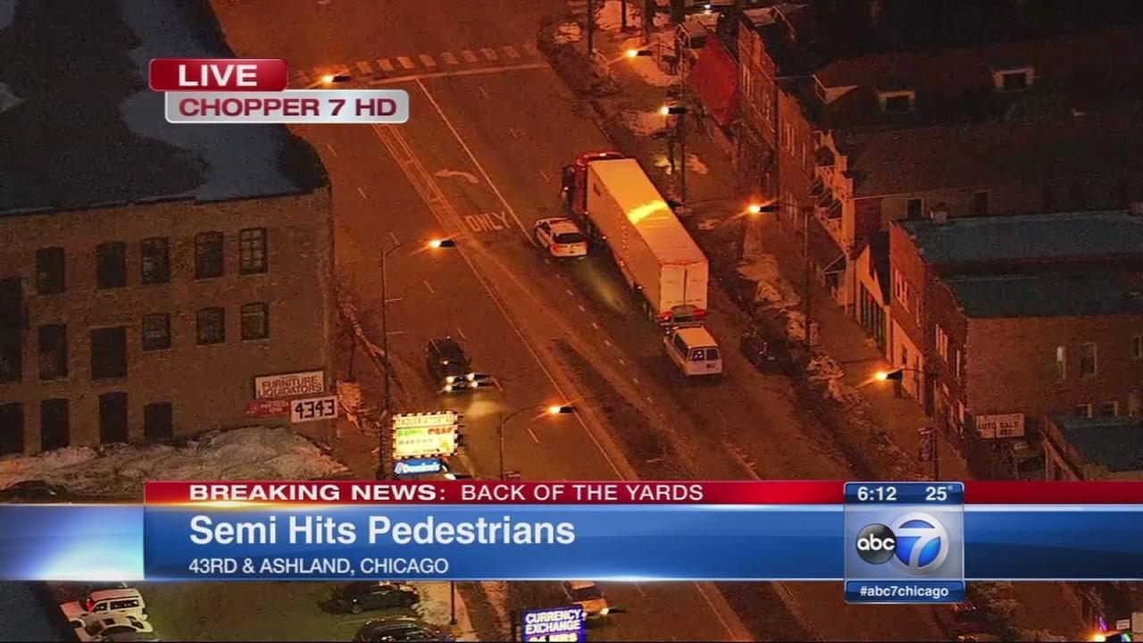 Semi hits pedestrians