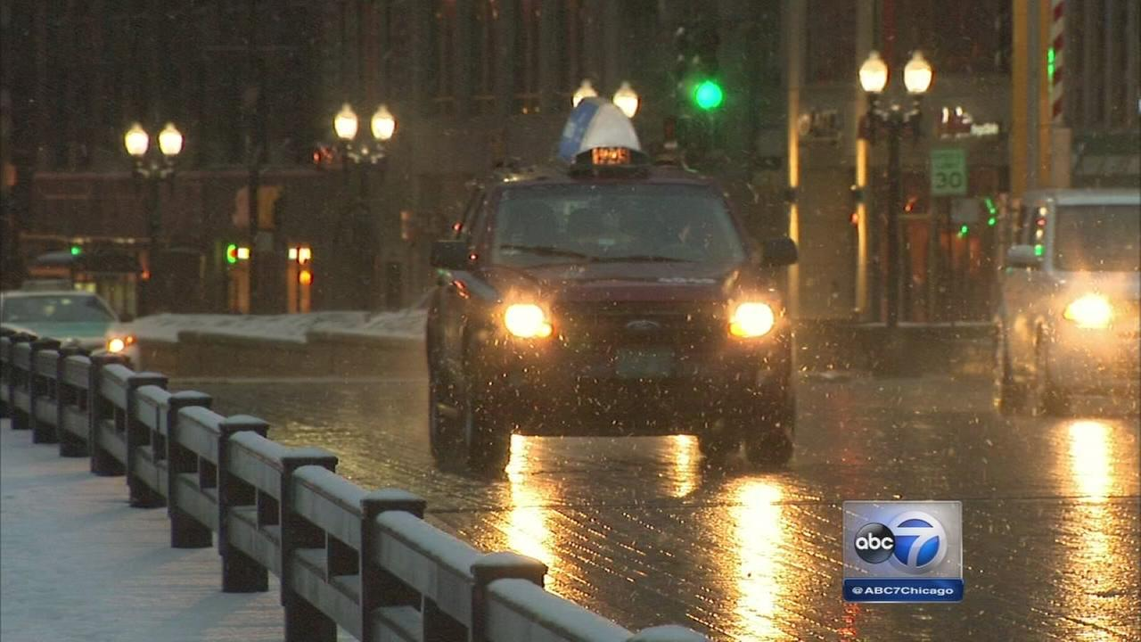 Snow, sub-zero temps mix for slick roads