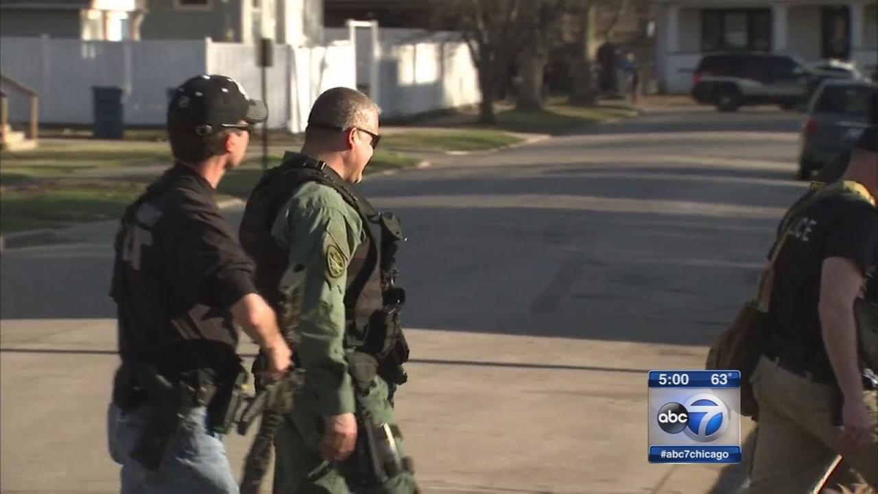 Manhunt underway; Officer recovering