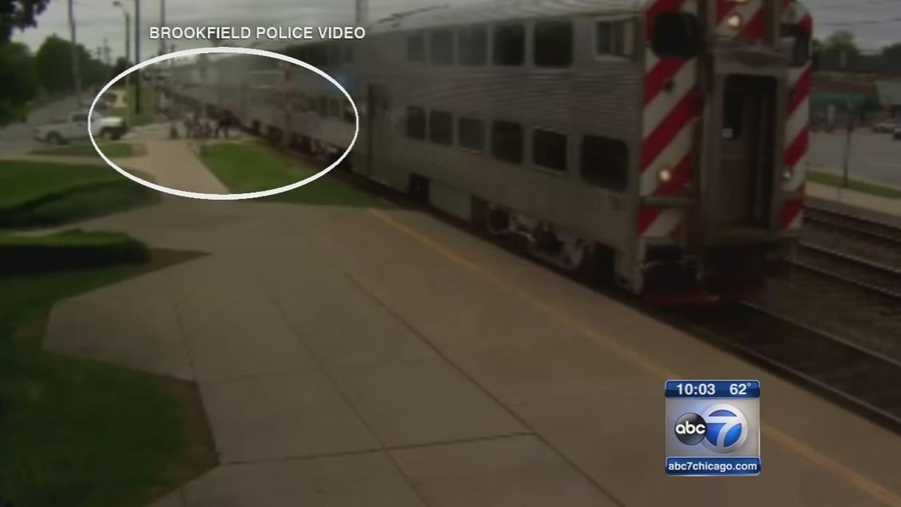 Disabled woman rescued after falling on Metra tracks
