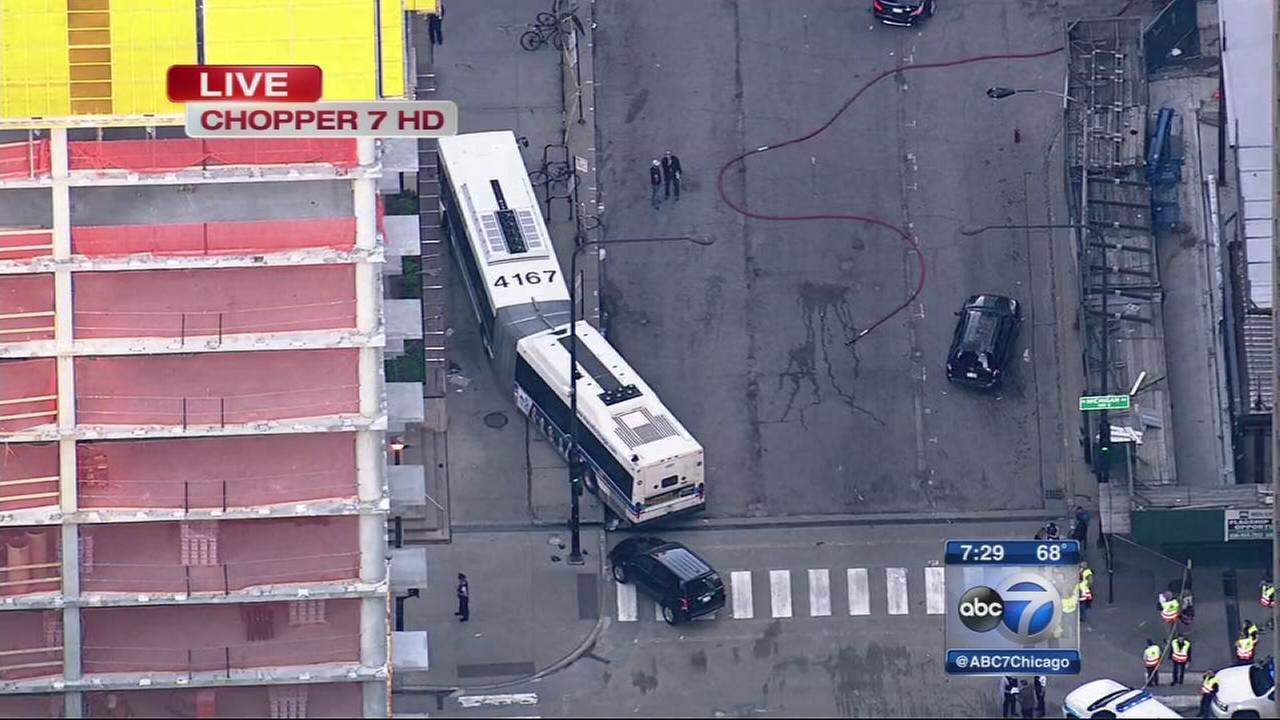 Michigan Ave. crash sends CTA bush onto plaza
