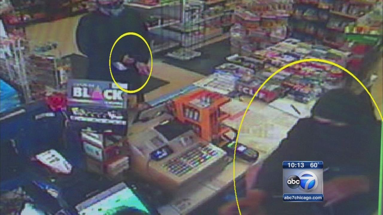 Video shows masked men hold clerk at gunpoint