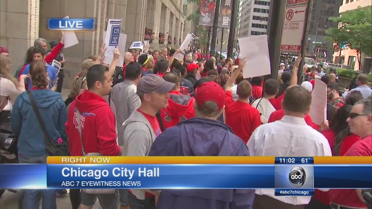 CPS teachers, parents protest layoffs