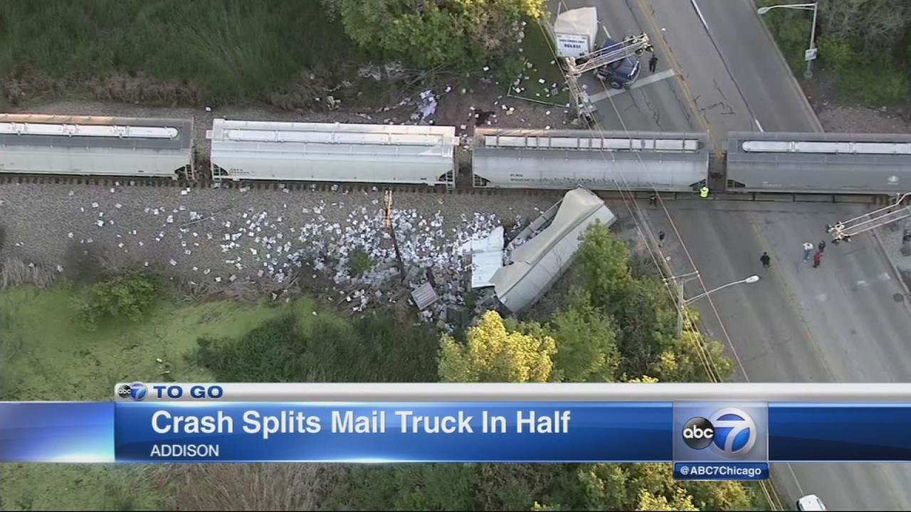 Crash splits mail truck in half