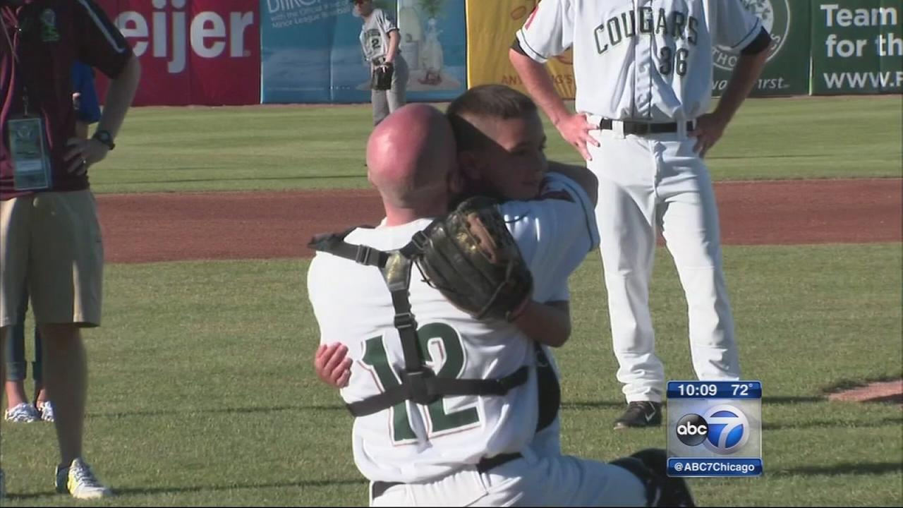 Military dad reunites with son on baseball field