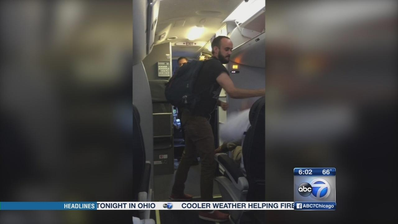 Passenger arrested after punching man on United flight