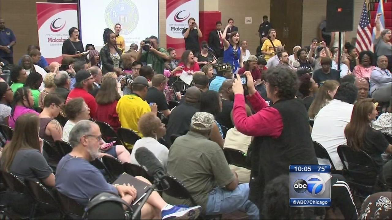 Protesters greet Emanuel at first budget meeting