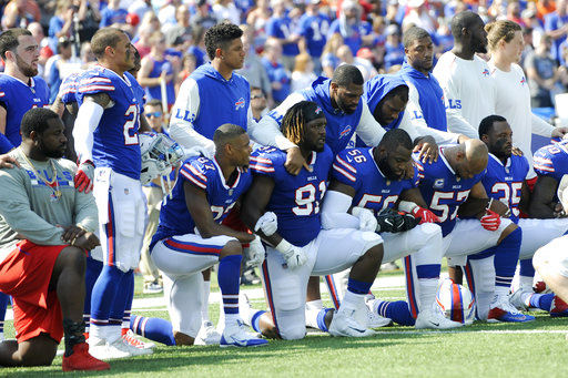 <div class='meta'><div class='origin-logo' data-origin='AP'></div><span class='caption-text' data-credit='AP Photo/Adrian Kraus'>Buffalo Bills players take a knee during the national anthem prior to an NFL football game against the Denver Broncos, Sunday, Sept. 24, 2017, in Orchard Park, N.Y.</span></div>