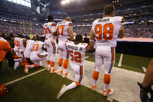 <div class='meta'><div class='origin-logo' data-origin='AP'></div><span class='caption-text' data-credit='AP Photo/Michael Conroy'>Members of the Indianapolis Colts take a knee during the Nation Anthem before an NFL football game against the Cleveland Browns in Indianapolis, Sunday, Sept. 24, 2017.</span></div>