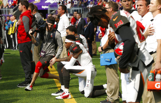 <div class='meta'><div class='origin-logo' data-origin='AP'></div><span class='caption-text' data-credit='AP Photo/Jim Mone'>Tampa Bay Buccaneers wide receiver DeSean Jackson, center, takes a knee during the national anthem before an NFL football game against the Minnesota Vikings in Minneapolis.</span></div>