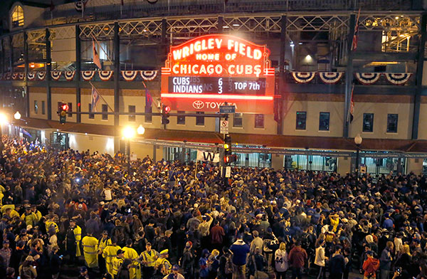 "<div class=""meta image-caption""><div class=""origin-logo origin-image none""><span>none</span></div><span class=""caption-text"">Chicago Cubs fans begin to gather outside Wrigley Field in Chicago as the marquee displays the current score of Game 7. (AP Photo/Charles Rex Arbogast)</span></div>"