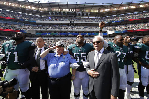 <div class='meta'><div class='origin-logo' data-origin='AP'></div><span class='caption-text' data-credit='AP Photo/Matt Rourke'>Philadelphia Eagles players and owners Jeffrey Lurie stand for the national anthem before an NFL football game against the New York Giants, Sunday, Sept. 24, 2017, in Philadelphia.</span></div>