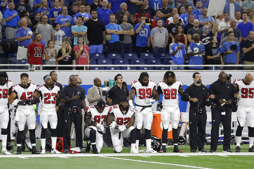 <div class='meta'><div class='origin-logo' data-origin='AP'></div><span class='caption-text' data-credit='AP Photo/Carlos Osorio'>Atlanta Falcons defensive tackles Grady Jarrett (97) and Dontari Poe (92) take a knee during the national anthem before an NFL football game, Sunday, Sept. 24, 2017, in Detroit.</span></div>