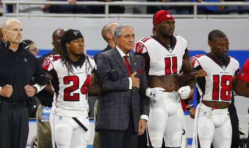 <div class='meta'><div class='origin-logo' data-origin='AP'></div><span class='caption-text' data-credit='AP Photo/Rick Osentoski'>Atlanta Falcons owner Arthur Blank stands with his players during the national anthem before an NFL football game against the Detroit Lions, Sunday, Sept. 24, 2017, in Detroit.</span></div>
