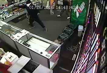 "<div class=""meta image-caption""><div class=""origin-logo origin-image none""><span>none</span></div><span class=""caption-text"">Gary police released surveillance images showing two suspects wanted in connection with a shooting at a cell phone store on Jan. 26, 2016.  (WLS Photo/ Gary Police Dept.)</span></div>"