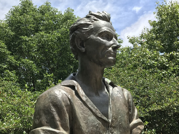 "<div class=""meta image-caption""><div class=""origin-logo origin-image wls""><span>WLS</span></div><span class=""caption-text"">The statue's flowing hair, unbuttoned collar and muscular arms have some on the internet calling him ""Baberham Lincoln.""</span></div>"