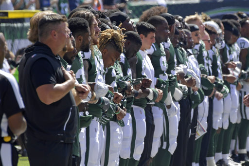 <div class='meta'><div class='origin-logo' data-origin='AP'></div><span class='caption-text' data-credit='AP Photo/Bill Kostroun'>New York Jets players lock arms during the playing of the national anthem against the Miami Dolphins before an NFL football game Sunday, Sept. 24, 2017, in East Rutherford, N.J.</span></div>