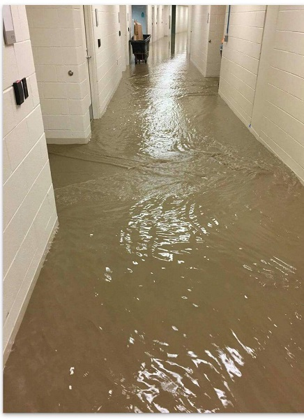 <div class='meta'><div class='origin-logo' data-origin='WLS'></div><span class='caption-text' data-credit=''>Flooding inside Northwestern Lake Forest Hospital.</span></div>