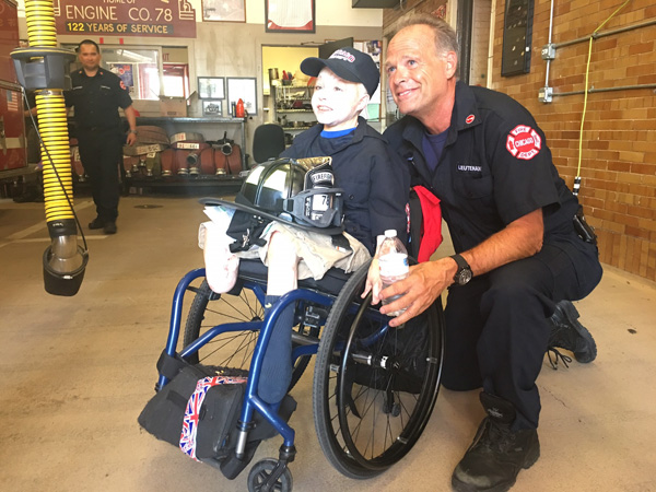 <div class='meta'><div class='origin-logo' data-origin='WLS'></div><span class='caption-text' data-credit=''>Owen Mahan, 9, was given a full uniform and made an honorary firefighter at Chicago Fire Department Engine 78 in Wrigleyville.</span></div>