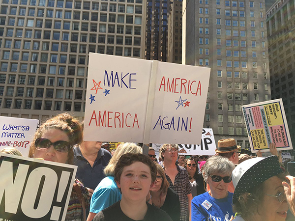 <div class='meta'><div class='origin-logo' data-origin='WLS'></div><span class='caption-text' data-credit=''>Protesters gather in Daley Plaza to call on President Trump to release his tax returns.</span></div>