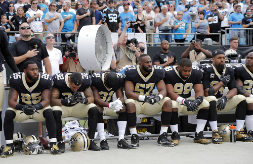 <div class='meta'><div class='origin-logo' data-origin='AP'></div><span class='caption-text' data-credit='AP Photo/Bob Leverone'>New Orleans Saints players sit on the bench during the national anthem before an NFL football game against the Carolina Panthers in Charlotte, N.C., Sunday, Sept. 24, 2017.</span></div>