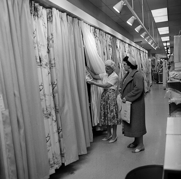 <div class='meta'><div class='origin-logo' data-origin='AP'></div><span class='caption-text' data-credit='AP Photo'>Shopper, Mrs. Arlene Hardt, right, is shown drapery samples by clerk Lucille Jagusch at the Golf-Mill Sears Roebuck department store in Niles, Ill., Aug. 23, 1961.</span></div>