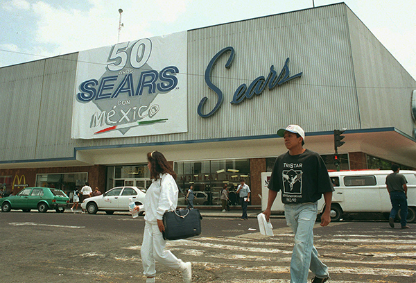 <div class='meta'><div class='origin-logo' data-origin='AP'></div><span class='caption-text' data-credit='AP Photo/Marco Ugarte'>People walk by the Sears store in Mexico City, Wednesday, April 2, 1997.</span></div>