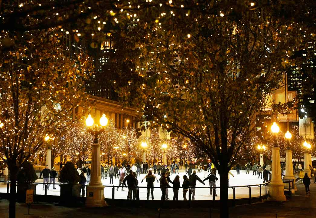 People skate under the Chicago skyline and thousands of lights in trees around the Millennium Park Ice Rink in Chicago on Dec. 5, 2008. <span class=meta>AP Photo/Charles Rex Arbogast</span>