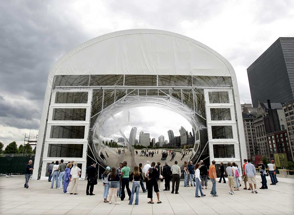 Only part of the Cloud Gate, affectionately called The Bean by Chicagoans, is on display while crews polish the seams of the 110-ton sculpture. <span class=meta>AP Photo/Charles Rex Arbogast</span>