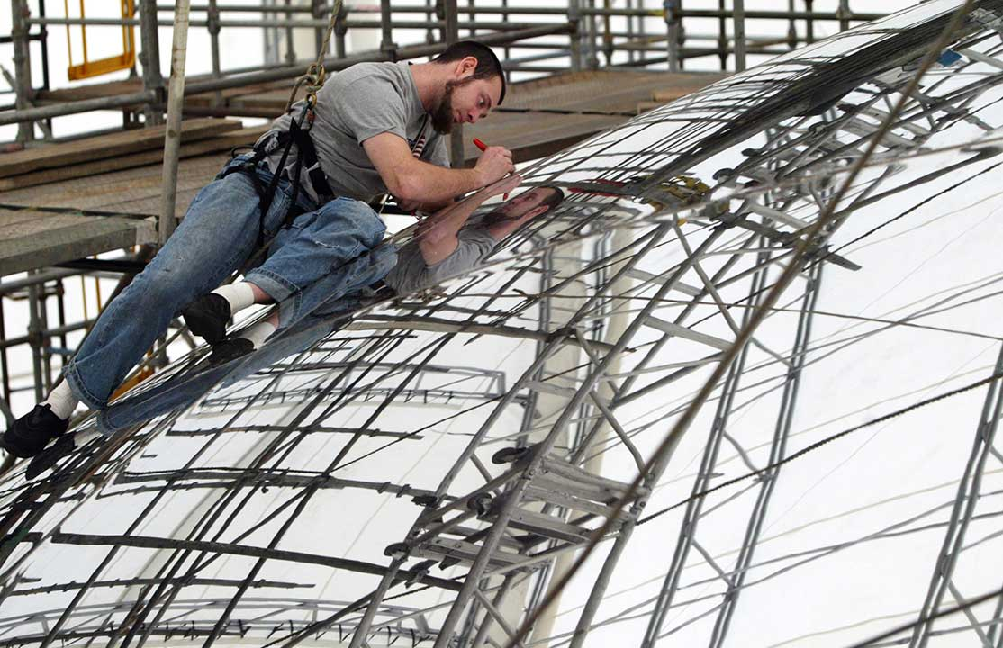 Andrew GiaCobbe marks off seams on the Cloud Gate, a stainless steel reflective sculpture in Millennium Park, Monday, March 7, 2005, in Chicago. <span class=meta>AP Photo/Nam Y. Huh</span>