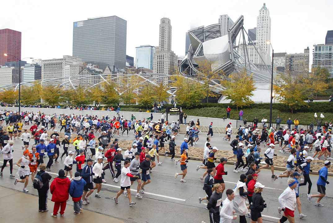 Runners head down Columbus Drive in front of Millennium Park and the Chicago skyline just after the start of the Chicago Marathon in Chicago on Sunday, Oct. 22, 2006. <span class=meta>AP Photo/Joseph Oliver</span>