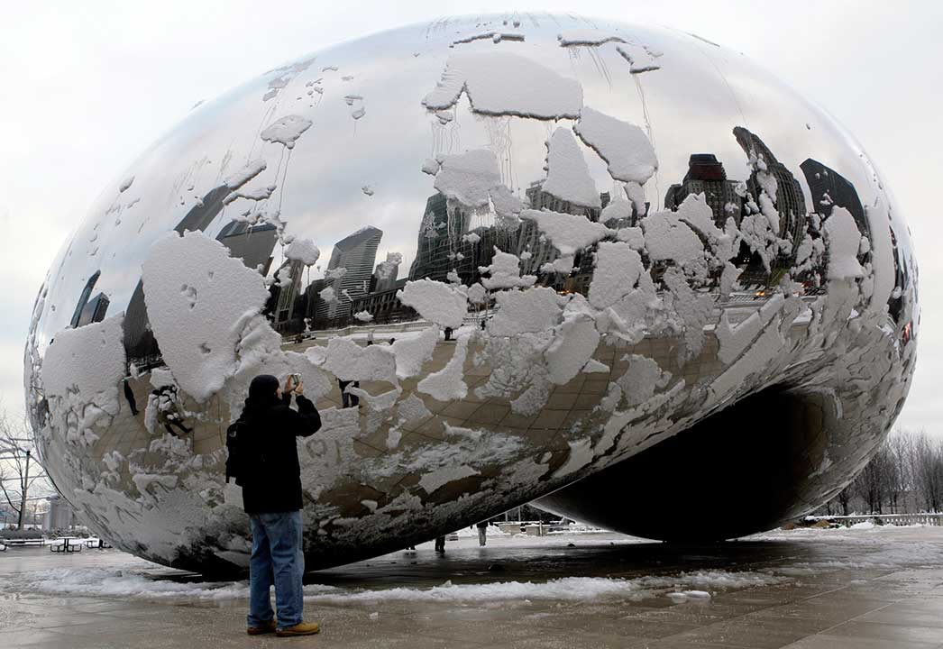 Patches of snow slide down the Cloud Gate sculpture at the Millennium Park in Chicago, Friday, Dec. 1. 2006. <span class=meta></span>