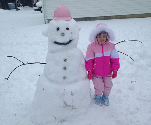 """<div class=""""meta image-caption""""><div class=""""origin-logo origin-image none""""><span>none</span></div><span class=""""caption-text"""">Maci stands proud with her """"Nuts and Bolts"""" snowman in Laurel Lake, New Jersey.  (Amanda )</span></div>"""