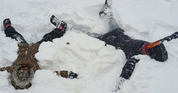 """<div class=""""meta image-caption""""><div class=""""origin-logo origin-image none""""><span>none</span></div><span class=""""caption-text"""">God sisters, 7-year-old Nzinga Collins and 19-year-old Nijiyyah Campbell, make snow angels outside their Upper Darby home. (Denise James News )</span></div>"""