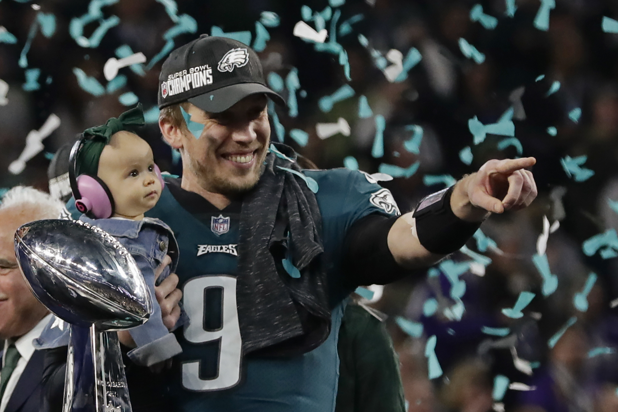 <div class='meta'><div class='origin-logo' data-origin='AP'></div><span class='caption-text' data-credit='AP Photo/Frank Franklin II'>Philadelphia Eagles quarterback Nick Foles (9) holds his daughter, Lily James, after winning the NFL Super Bowl 52 football game.</span></div>