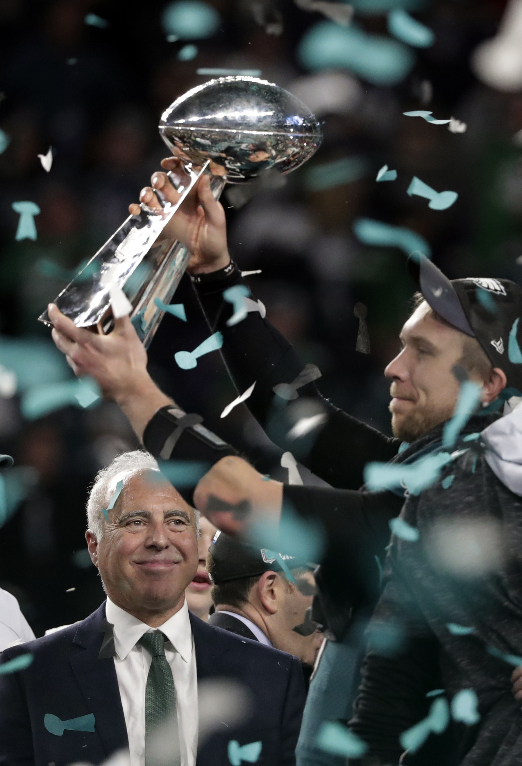 <div class='meta'><div class='origin-logo' data-origin='AP'></div><span class='caption-text' data-credit='AP Photo/Tony Gutierrez'>Philadelphia Eagles quarterback Nick Foles hoists the Vincent Lombardi trophy as owner Jeffrey Lurie, smiles after winning the NFL Super Bowl 52 football game.</span></div>