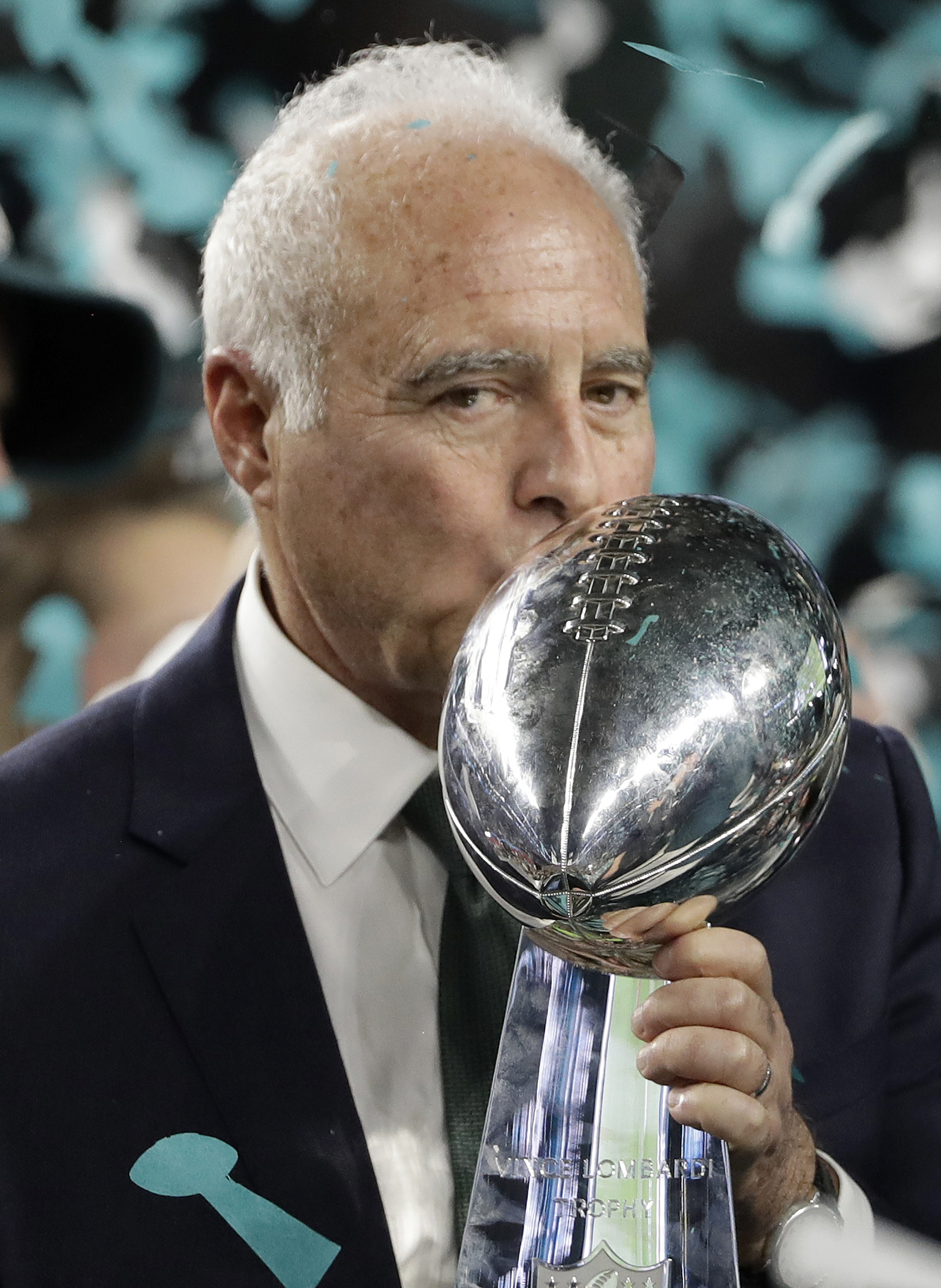 "<div class=""meta image-caption""><div class=""origin-logo origin-image ap""><span>AP</span></div><span class=""caption-text"">Philadelphia Eagles owner Jeffrey Lurie kisses the Vince Lombardi Trophy after the NFL Super Bowl 52 football game against the New England Patriots. (AP Photo/Chris O'Meara)</span></div>"