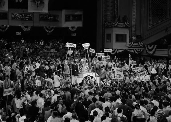 """<div class=""""meta image-caption""""><div class=""""origin-logo origin-image none""""><span>none</span></div><span class=""""caption-text"""">Delegates, yelling and cheering, hold their state banners high as they pass the speaker's rostrum during a tumultuous demonstration for Senator Alben W. Barkley of Kentucky. (Photo/Murray Becker)</span></div>"""