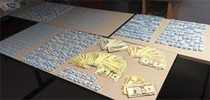 <div class='meta'><div class='origin-logo' data-origin='none'></div><span class='caption-text' data-credit=''>Pictured: Drugs seized after arrest of Darren Swiggett.</span></div>