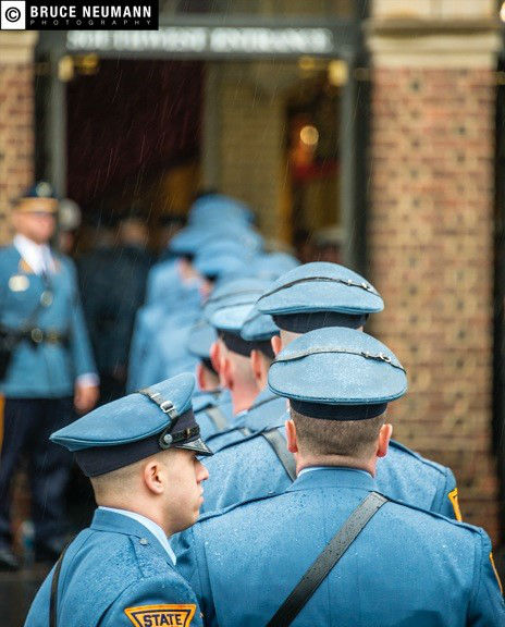 <div class='meta'><div class='origin-logo' data-origin='none'></div><span class='caption-text' data-credit=''>Family, friends, and fellow police officers gathered to pay a final tribute to slain Philadelphia Officer Robert Wilson III.</span></div>