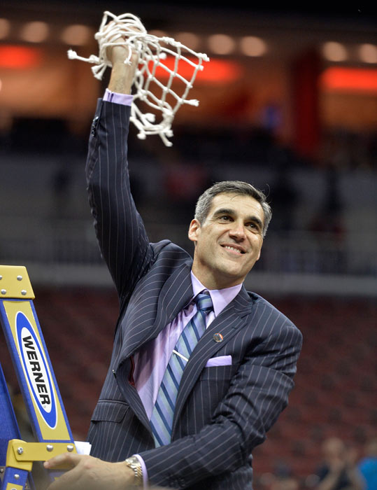 <div class='meta'><div class='origin-logo' data-origin='AP'></div><span class='caption-text' data-credit='AP Photo/Timothy D. Easley'>Villanova head coach Jay Wright hold a portion of the net after a regional final men's college basketball game against Kansas in the NCAA Tournament, Saturday, March 26, 2016.</span></div>