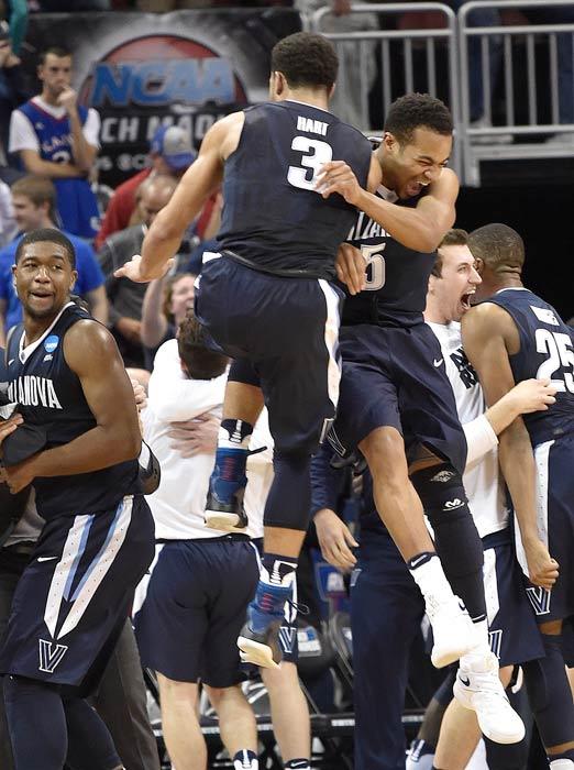 "<div class=""meta image-caption""><div class=""origin-logo origin-image ap""><span>AP</span></div><span class=""caption-text"">Villanova guard Josh Hart (3) and Villanova guard Phil Booth (5) celebrate after a regional final men's college basketball game in the NCAA Tournament against Kansas. (AP Photo/John Flavell)</span></div>"