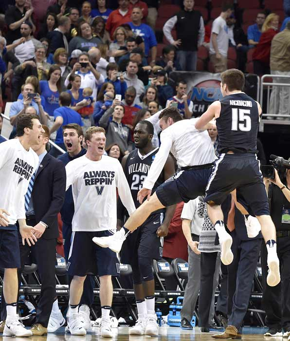 <div class='meta'><div class='origin-logo' data-origin='AP'></div><span class='caption-text' data-credit='AP Photo/John Flavell'>Villanova players celebrate after a regional final men's college basketball game against Kansas in the NCAA Tournament, Saturday, March 26, 2016, in Louisville, Ky.</span></div>