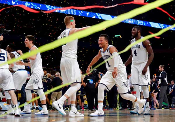 <div class='meta'><div class='origin-logo' data-origin='AP'></div><span class='caption-text' data-credit=''>Villanova basketball players celebrate after the championship game of the NCAA college basketball tournament championship game against Michigan.</span></div>