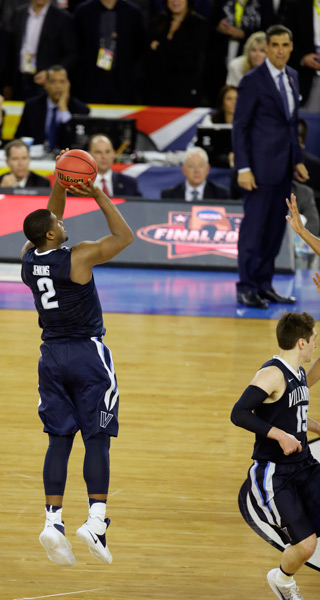 <div class='meta'><div class='origin-logo' data-origin='AP'></div><span class='caption-text' data-credit='AP Photo/Charlie Neibergall)'>Villanova's Kris Jenkins (2) shoots a game winning three point basket in the closing seconds of the NCAA Final Four tournament college basketball championship game.</span></div>