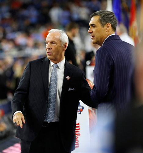 <div class='meta'><div class='origin-logo' data-origin='AP'></div><span class='caption-text' data-credit='AP Photo/David J. Phillip'>North Carolina head coach Roy Williams, left, and Villanova head coach Jay Wright shake hands before the NCAA Final Four tournament college basketball championship game.</span></div>